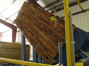Side view of lumber raised by tilt hoist